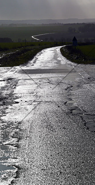 """Wet road on the Plain"" by Derek Gale"